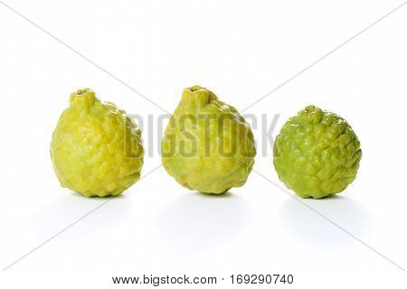 Three pieces of yellow Mauritius papeda fruit isolated on white background