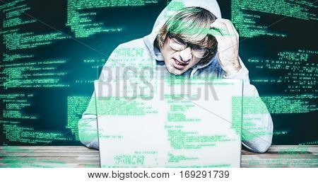 Man in hood jacket hacking a laptop against green background with vignette Man in hood jacket hacking a laptop on black background