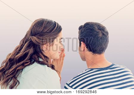Woman whispering secret to boyfriend against purple