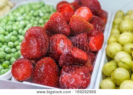 Frozen Strawberry on a shelf in a supermarket. Frozen fruits and vitamins concept. Healthy eating