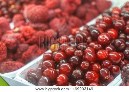 Close-up of frozen fruit in supermarket. Raspberries. cowberry, healthy food