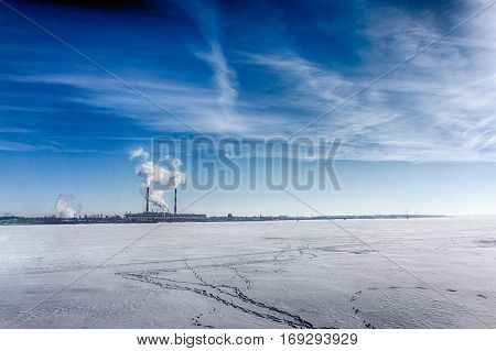 Industrial zone, petrochemical industry on sunset and Twilight sky, Power plant, Energy power station area on frozen winter lake. HDR image, copy space
