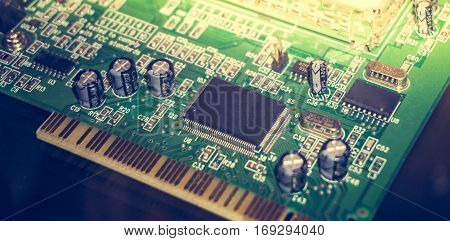 Printed Circuit Board with many electrical components. Close up image. Technology and hardware electronic concept. Toned picture
