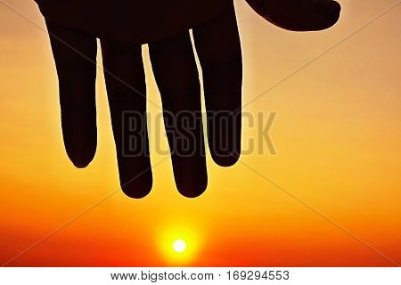 Blur Focus Sunset sky and silhouette hand icon