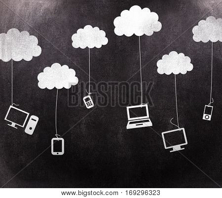 Media devices hanging from clouds against black background