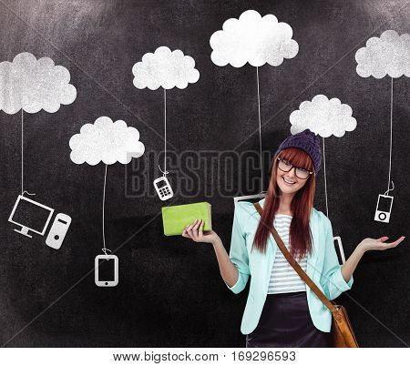 Smiling hipster woman with bag and book against black background