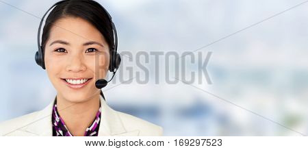 Attractive female engineer smiling at the camera against close up of swivel chair in an office