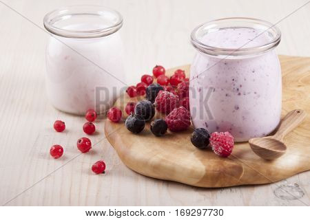 Smoothies with frozen berries red currants black currants and raspberries in two banks