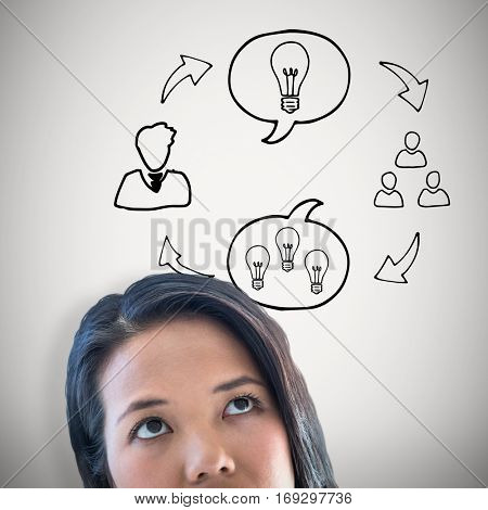 Thoughtful businesswoman with finger on chin against grey background