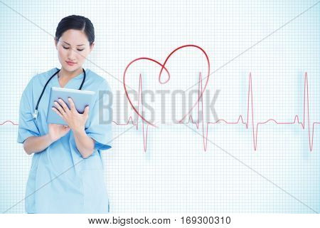 Surgeon using digital tablet with group around table in hospital against red ecg line with heart graphic on grid background