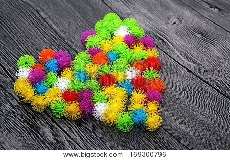 Colorful toy designer Velcro burdock wooden background