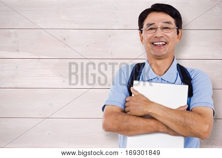 Portrait of cheerful man holding documents against bleached wooden planks background