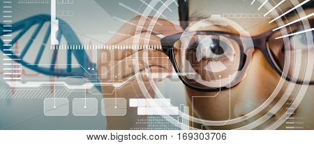 Close up view of a businesswoman holding her eyeglasses against blue medical background with dna and ecg