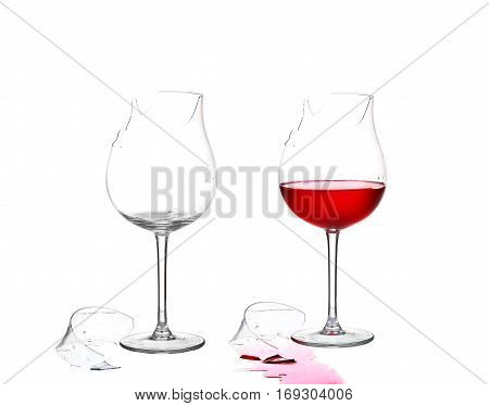 Two Broken Glass And Empty With Red Wine On White Isolate