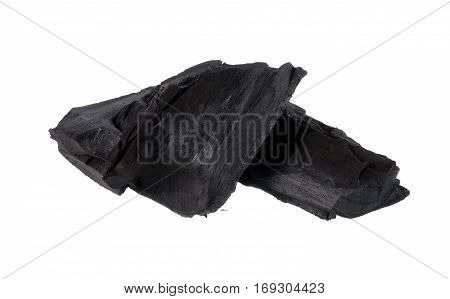 Closeup charcoal isolated on white background. carbon