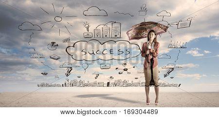 Businesswoman with an umbrella against ominous landscape