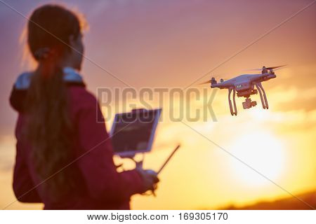 drone flying at sunset