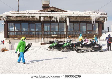 Sochi, Russia - 30 December, People and snowmobiles, 30 December, 2016. Winter mountain ski resort Rosa Khutor.