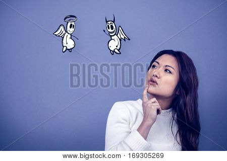 Thoughtful Asian woman with finger on chin against blue background