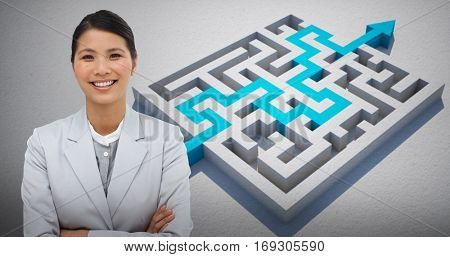 Smiling businesswoman with folded arms against blue arrow solving puzzle