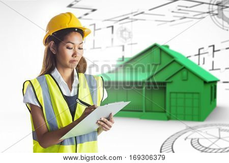 Architect woman with yellow helmet and plans against big house in grey with architect plans