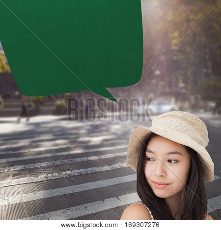 Woman with a straw hat looking away against picture of a city