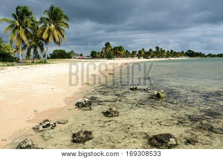 Playa Giron Cuba - 19 january 2016: people he peaceful sandy beach named Playa Giron which are on the southern part of Cuba