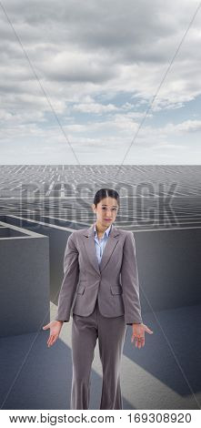 Portrait of a confused young businesswoman against cloudy sky over maze