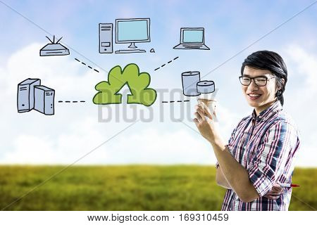 Smiling creative businessman with take-away coffee against digital image of grassy field