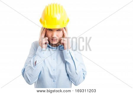 Female Engineer Wearing Helmet Making Head Ache Gesture