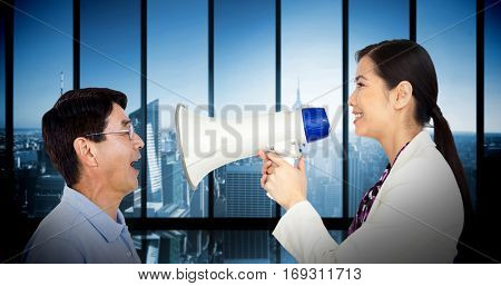 Elderly man with mouth open against room with large window looking on city