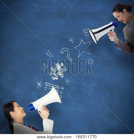 Portrait of a businesswoman shouting through a megaphone against blue chalkboard