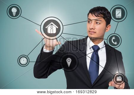 Unsmiling businessman holding and pointing against blue vignette background