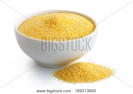Cornmeal Polenta In White Ceramic Bowl Isolated On White. Spilled Cornmeal.