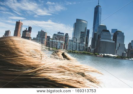 New York, tourists people on cruise boat. Young blonde traveler visiting famous American destination. Speed boat cruise.