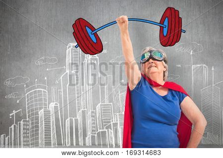 Senior woman disguise as superhero with hand raised against hand drawn city plan