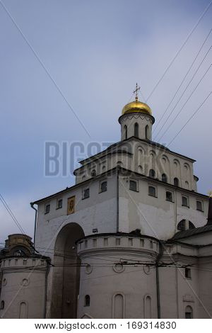 Old white stone church with cross on the cupola in Vladimir, Russia