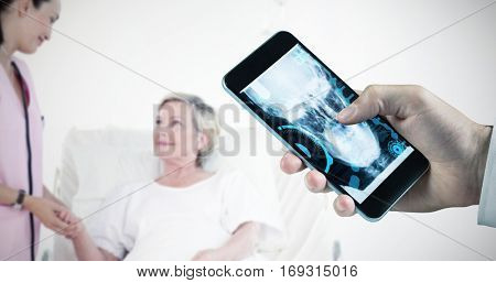 hand holding smartphone against beatiful nurse with a elderly woman