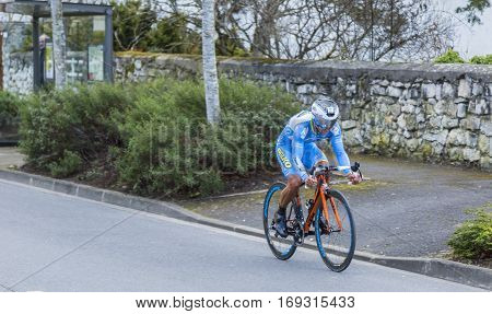 Conflans-Sainte-HonorineFrance-March 62016: The French cyclist Leonardo Fabio Duque of Delko-Marseille Provence-KTM Team riding during the prologue stage of Paris-Nice 2016.
