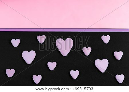 a pattern of serenity hearts on a black background with rose quarts and serenity copy-space