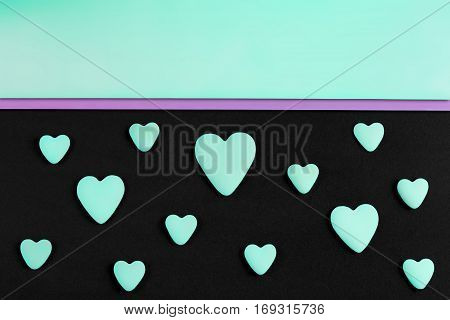 a pattern of tiffany hearts on a black background with tiffany copy-space