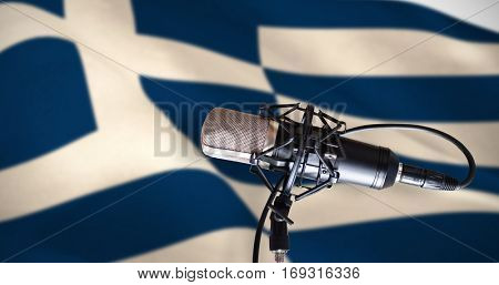 Condenser microphone against digitally generated greek national flag