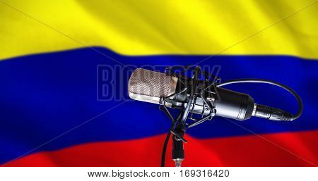 Condenser microphone against digitally generated colombia national flag