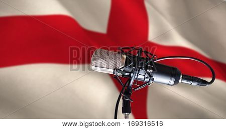 Condenser microphone against digitally generated english national flag