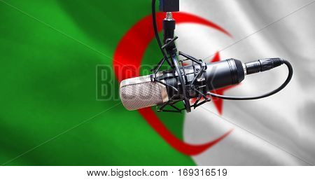 Condenser microphone against digitally generated algerian national flag