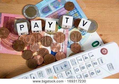white remote with money - smybol for pay tv