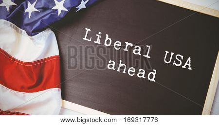liberal usa ahead against american flag on chalkboard