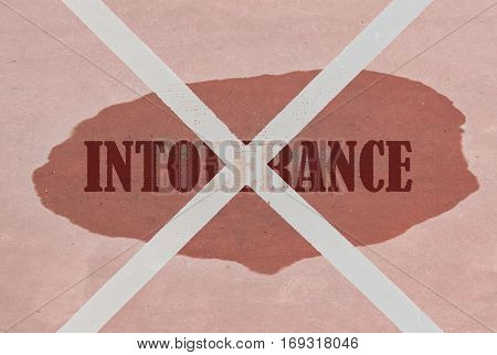 Strikethrough word Intolerance written on pink background
