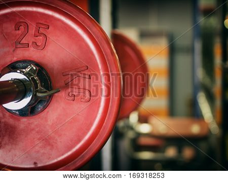 Barbell ready to workout in gym. Shallow DOF. Copy space. Sport or powerlifting background. Toned image.