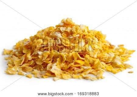 Heap Of Dry Flaked Corn Isolated On White.